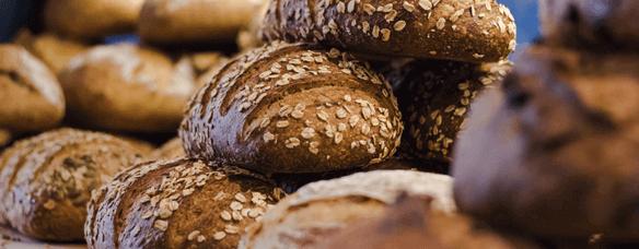 Honey oat bread has horizontal cuts flecked with hearty oats