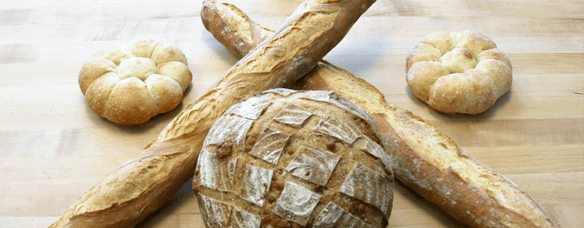 Whole Clove Roasted Garlic loaves in different shapes and sizes